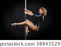 beautiful pole dancer in leather jacket on pylon 38843529
