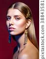 beautiful girl with long earrings 38843581
