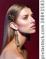 beautiful girl with long earrings 38843583