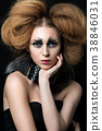 Beauty portrait of young woman with fashion makeup 38846031