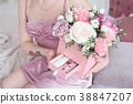 Young dreaming woman holding Square Pink Flower 38847207