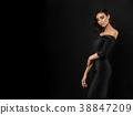 Young beautiful woman wearing black evening dress 38847209
