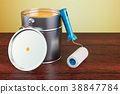 Can with paint and roller brush on wooden table 38847784