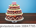 Chocolate Birthday Cake with candles on stand 38847785