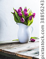 A bouquet of purple tulips in a vase 38856243