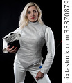 Portrait of adult woman fencer 38870879