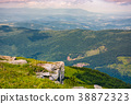 rocky cliff over the valley with rolling hills 38872323