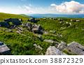 rocky formation on grassy hillside 38872329
