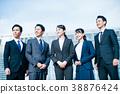 ผู้ชายและผู้หญิงในชุดธุรกิจ 38876424