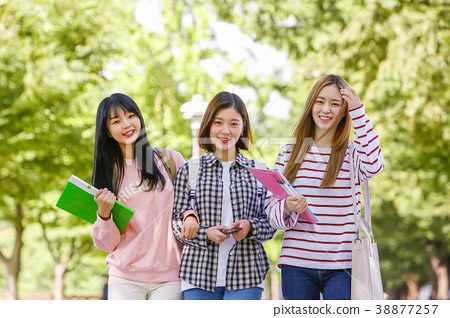 Campus life - freshmen enjoy theirs the campus life. young college students walking on around of campus. 088 38877257