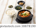 Delicious Korean food - kind of noodles, soup with rice and side dish with fish on the table. 081 38878190