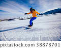 woman snowboarder snowboarding in winter mountains 38878701