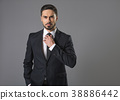 Disgruntled serious-minded businessman 38886442