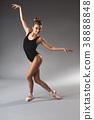 Smiling fit ballerina dancing in swimsuit 38888848