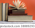 Open book, hardback books on wooden table. Back to 38889293