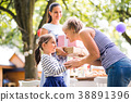 Family celebration or a garden party outside in 38891396
