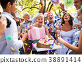 Family celebration or a garden party outside in 38891414