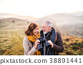 Senior couple on a walk in an autumn nature. 38891441