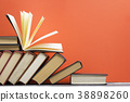 Open book, hardback books on wooden table. Back to 38898260