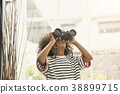 Child cute acting look explorer with telescope. 38899715