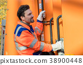 Waste collector gripping handle of garbage truck 38900448