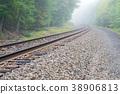 Train track into the fog 38906813