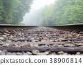 Train track into the fog 38906814