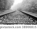 Train track into the fog 38906815