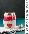 Valentine's Day Chia pudding with strawberry heart 38915112