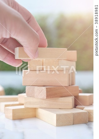 Focus at the hand try to building wooden block 38918981