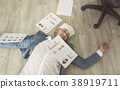 Businessman overworked his sleep in office.  38919711