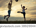 Happy young little boy and girl playing in the field  with socce 38920044