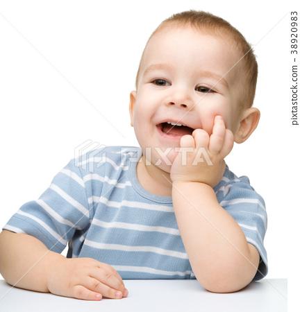 Portrait of a cute cheerful little boy 38920983