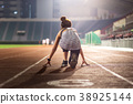 Happy young female athlete at starting position 38925144