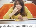 A woman relaxing with kotatsu 38925613