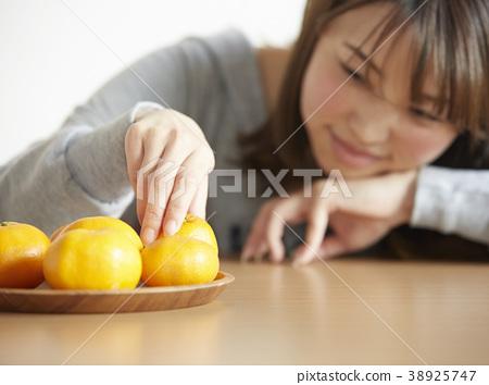 A woman relaxing with kotatsu 38925747