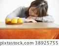 A woman relaxing with kotatsu 38925755
