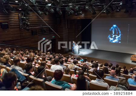 Business speaker giving a talk in conference hall. 38925884