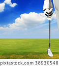 Golf player holding a golf club in golf course 38930548
