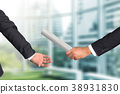 businessman passing relay baton to colleague 38931830