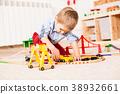 Boy plays with train  38932661