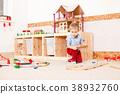 Boy plays with train  38932760