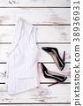 Women classic waistcoat and black stilettos. 38936931