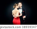 Elegant couple in evening dress embracing each 38939347