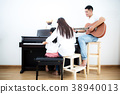Parents and daughter playing music 38940013