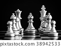The King in battle chess game stand on chessboard 38942533