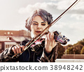 Woman perform music on violin park outdoor. Girl 38948242