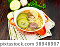 Soup with zucchini and noodles in bowl 38948907