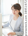 Young woman working in office 38951972