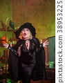 Photo of screaming witch in black hat, dress on 38953225
